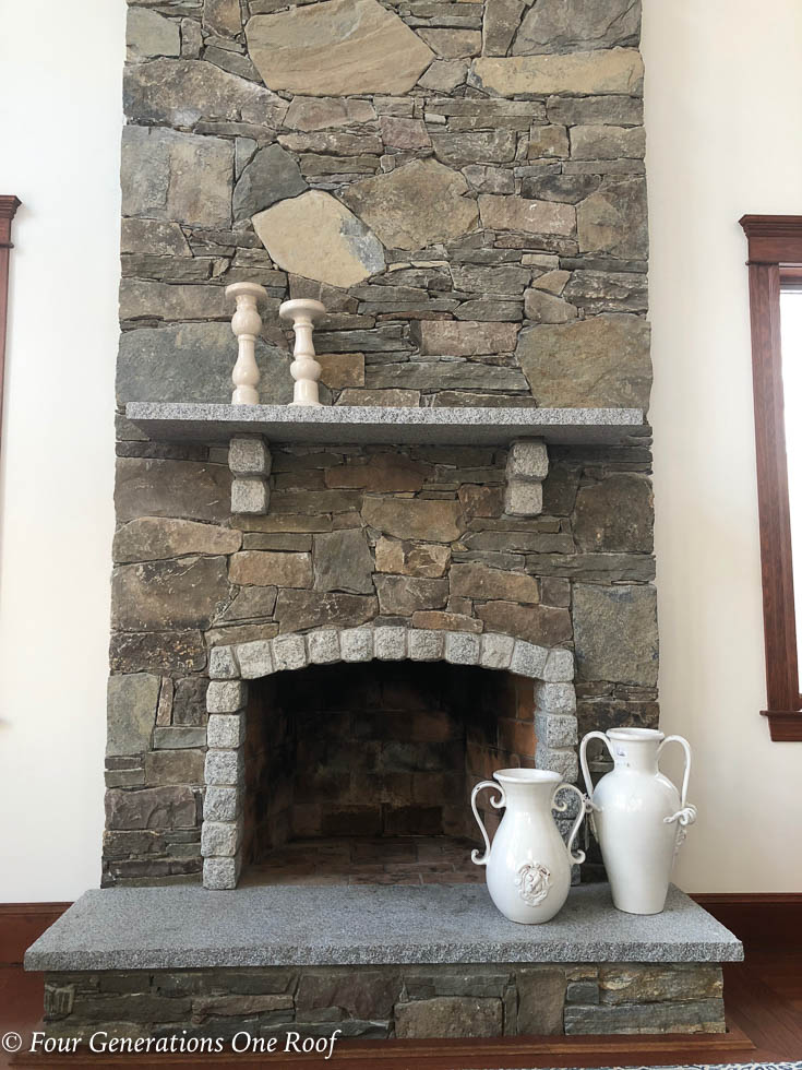 living room before with granite stone fireplace, granite mantel slab