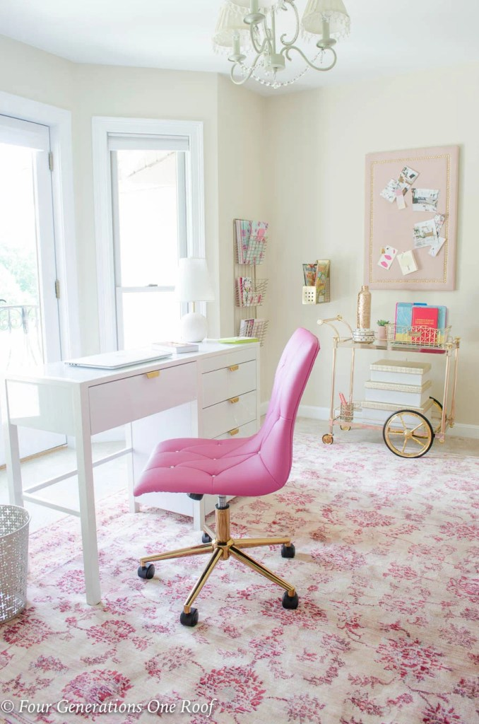 Sophisticated Adult Pink + Gold Office Workspace with white desk, pink chair, pink rug and gold bar cart