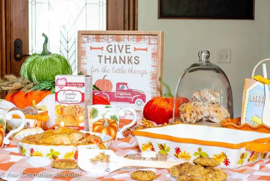 Kitchen Island Fall Snack Station with pumpkins, apple pie, apple cider, donuts and baked goods