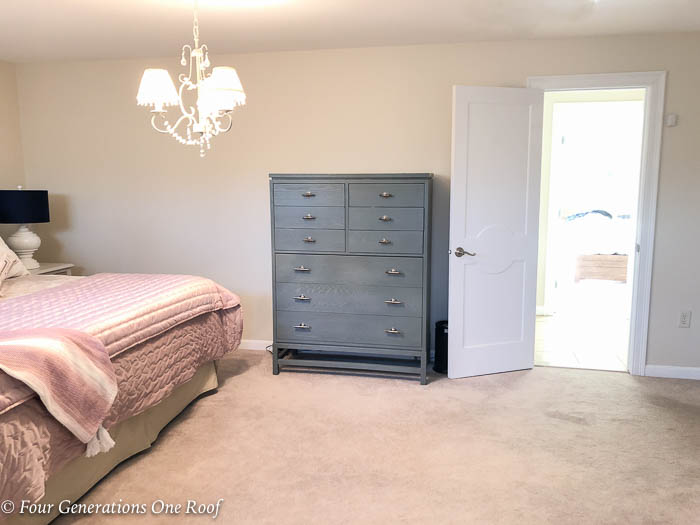 Master bedroom, green bureau with pink bedding, tan walls and blue lamp shades