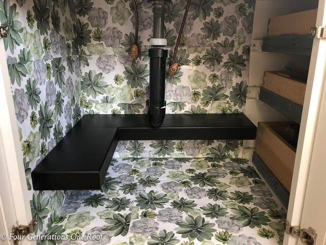 DIY Shelf under bathroom sink idea using a premade shelf