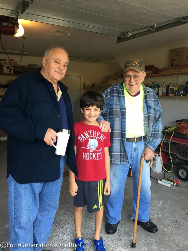 great grandfather, grandfather and grandson in garage