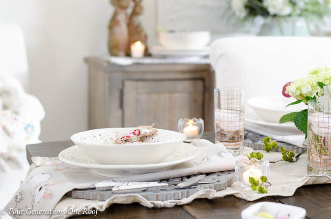 Easter table setting idea with white dishes and gold glassware