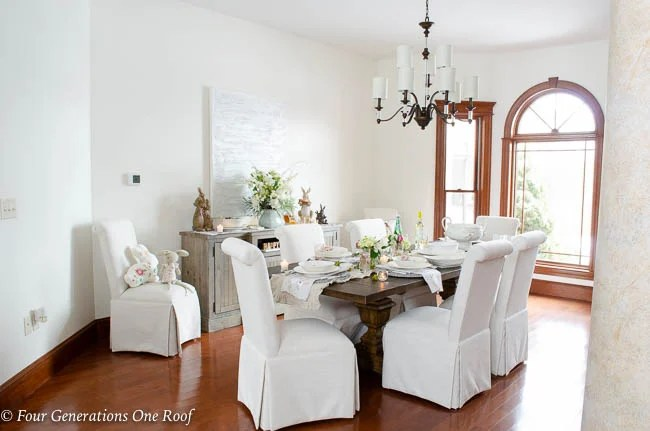 style change lighting updates in our home, Arhaus dining table, slipcovered parson chairs, Hinkley Modern Traditional Chandelier, greenery,