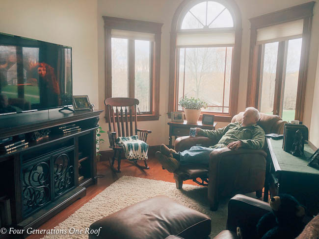 multigenerational family, my dad in tv room watching Disney's movie Brave with the tv very loud