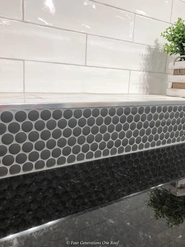 white subway tile, black penny tile, black granite