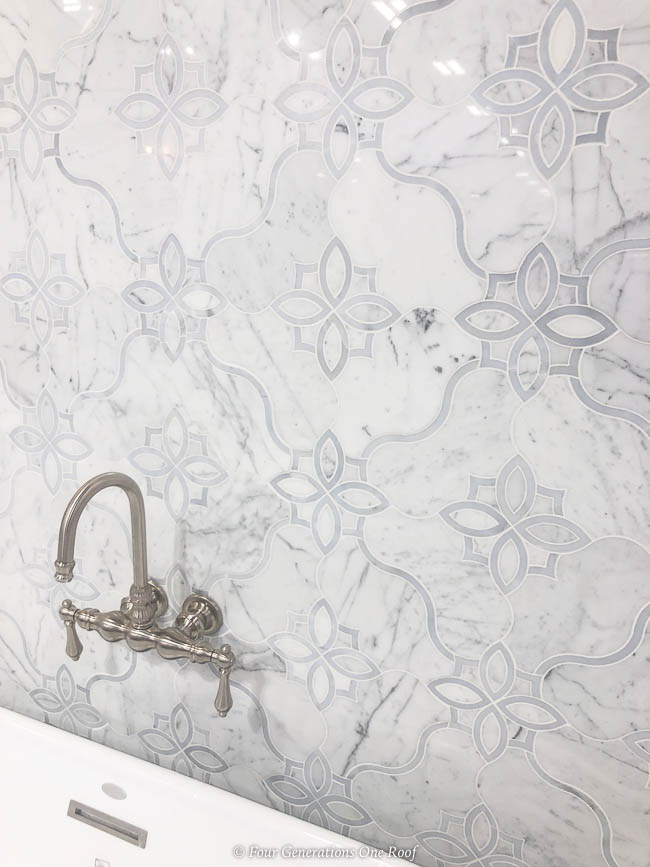 white quartzite wall tile with satin nickel bathroom faucet for soaking tub