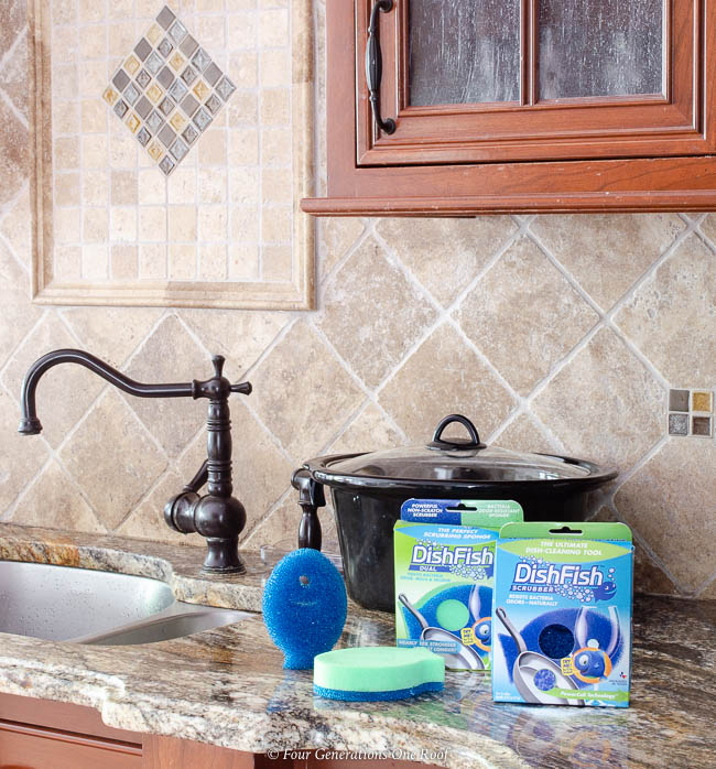 DishFish Scrubber Cleaning Tools with crockpot on a kitchen counter