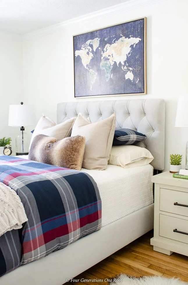 Tiny White Guest Bedroom, Adjustable Base Bed, world map wall art, plaid duvet, glass jar lamp, gray velour headboard, white night table