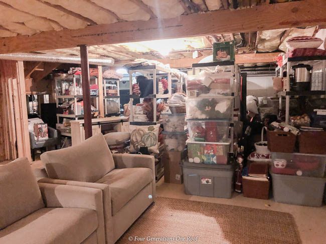 stacked bins of decorating decor in basement