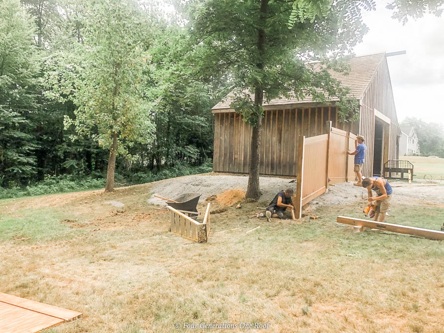 post and beam barn, brown PVC fence