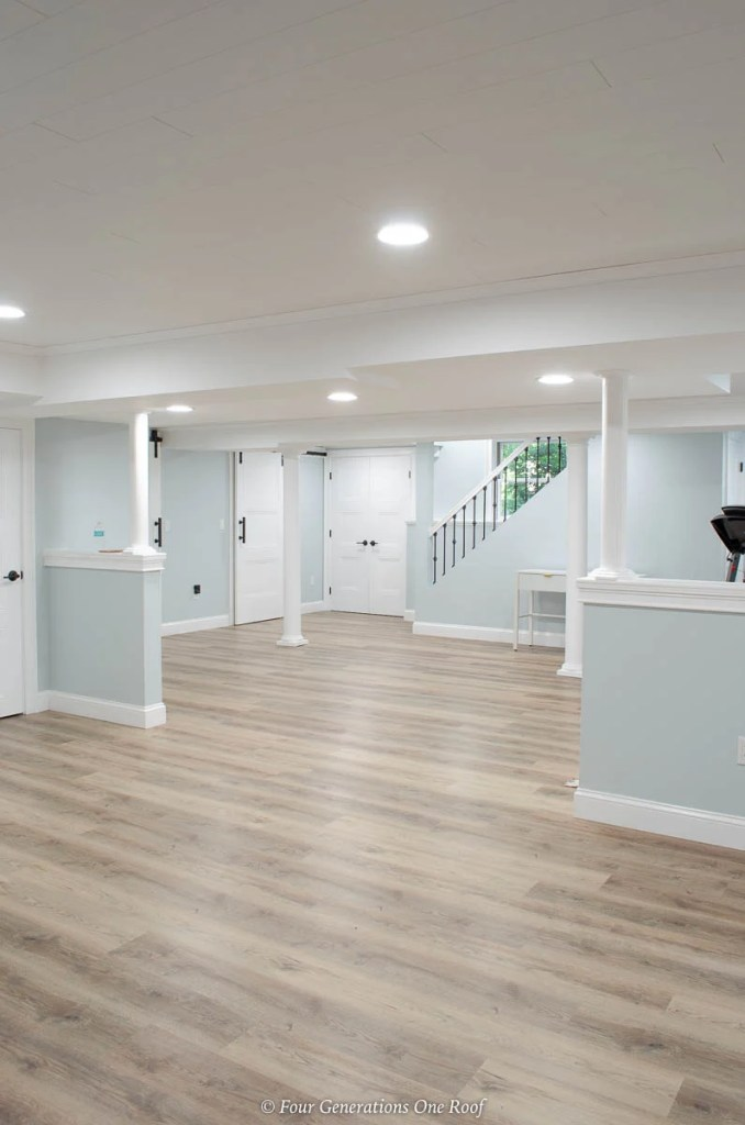 Basement Makeover With White Ceiling And Vinyl Floor Planks Four Generations One Roof