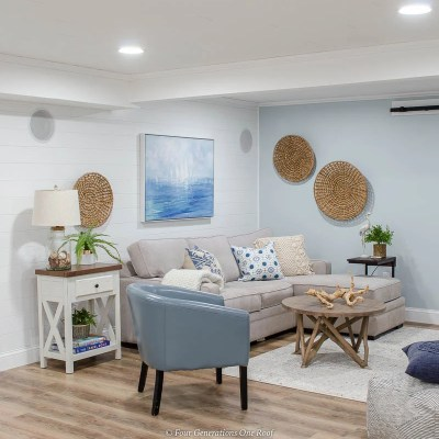 driftwood planks, white plank wall, modern coastal basement family room, blue walls, seagrass baskets on walls
