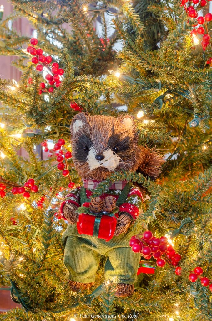 Christmas rustic squirrel dressed in overalls, christmas tree, red berries