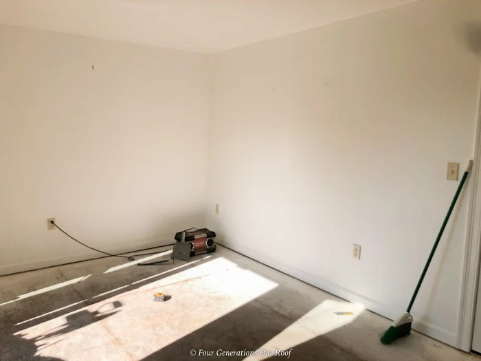 empty spare bedroom with plywood flooring