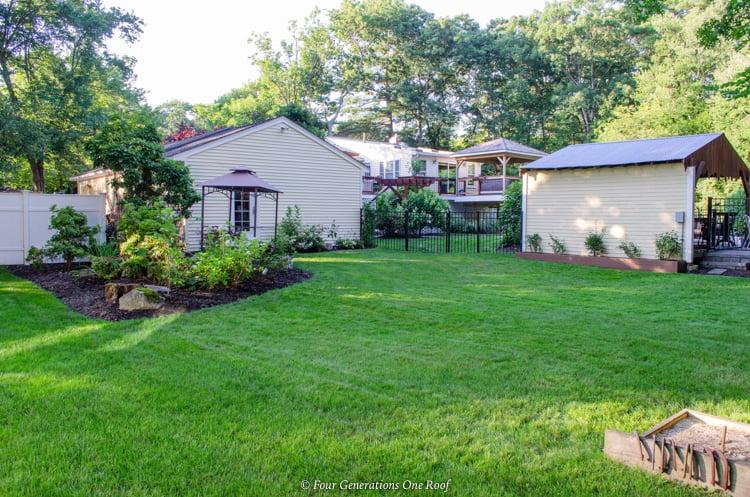 split level house backyard shed, pool cabana, green grass
