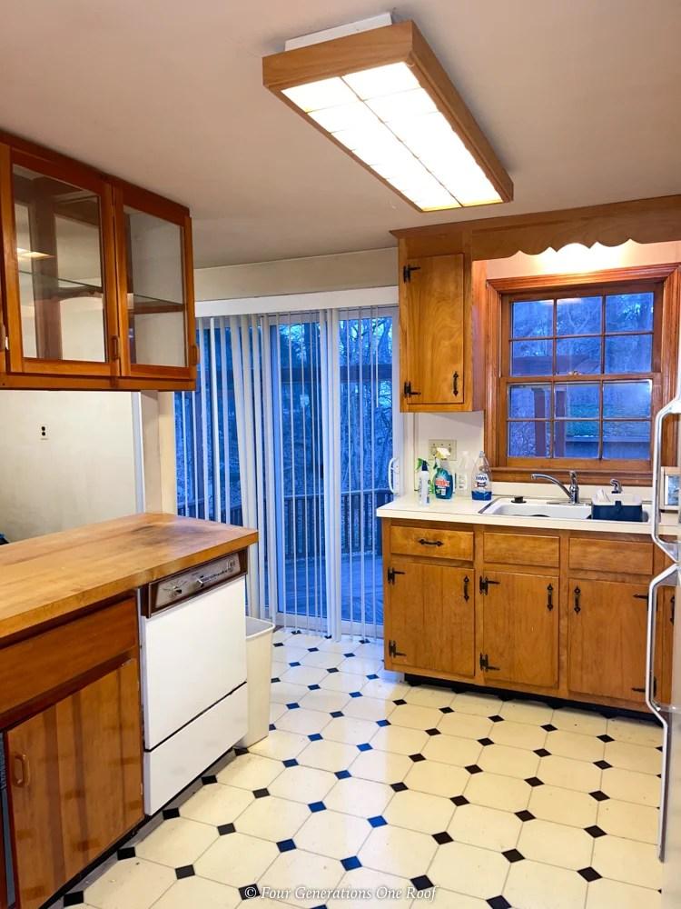 1970s split level kitchen with black diamond linoleum brown cabinets