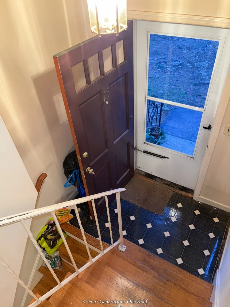 split level entryway with white iron stair rail
