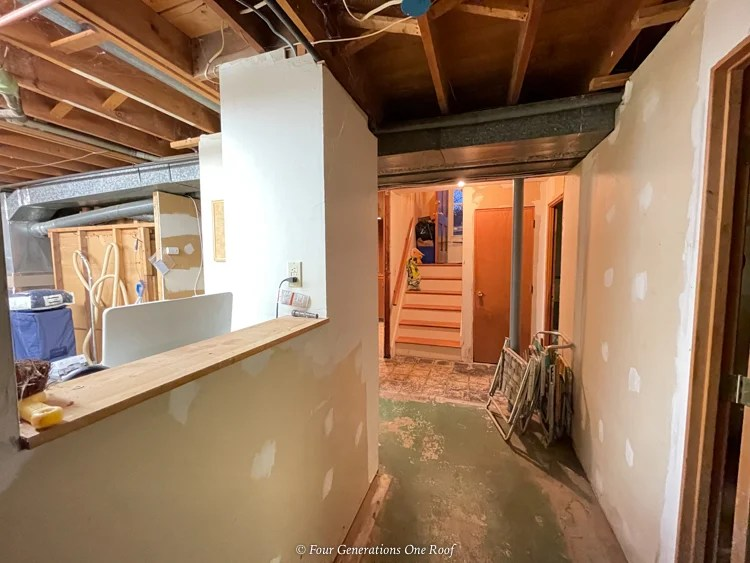split level home unfinished basement with cement floors