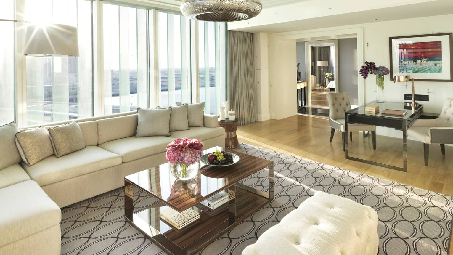 the living room mattress abu dhabi how to decorate with no fireplace hotel suites luxury rooms four seasons deluxe executive suite l shaped white sofa bench against