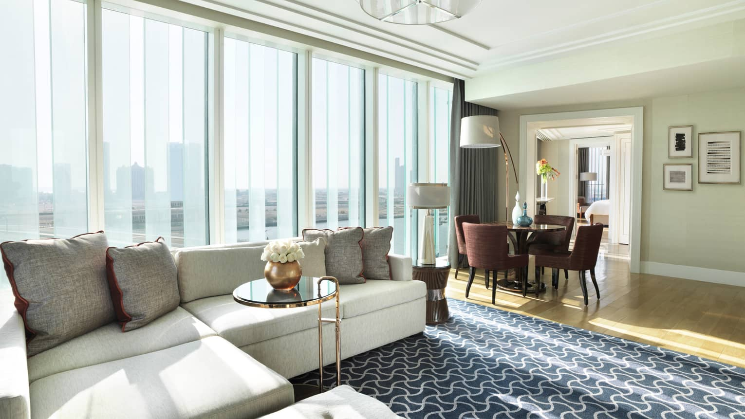 living room restaurant abu dhabi ideas with dark brown furniture hotel luxury four seasons al maryah island deluxe executive suite large l shaped white sofa against