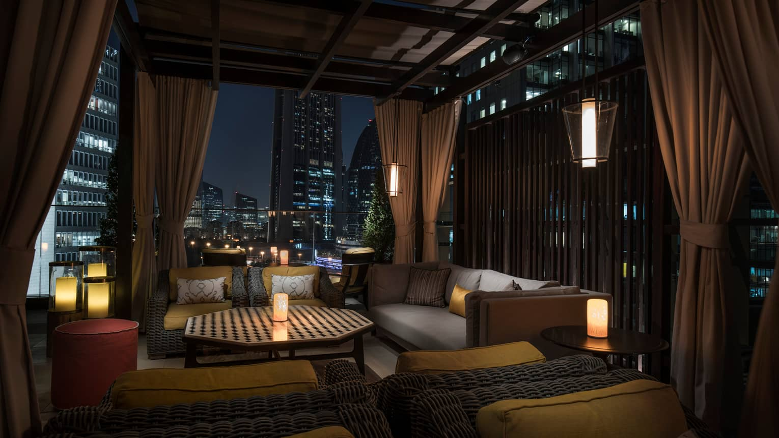 the living room with sky bar images rooftop in dubai luna at four seasons hotel difc outdoor patio lounge area night candles plush cushions wood roof