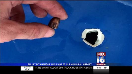 Bullet Hits Hangar and Plane at NLR Municipal Airport_7361594684115273657