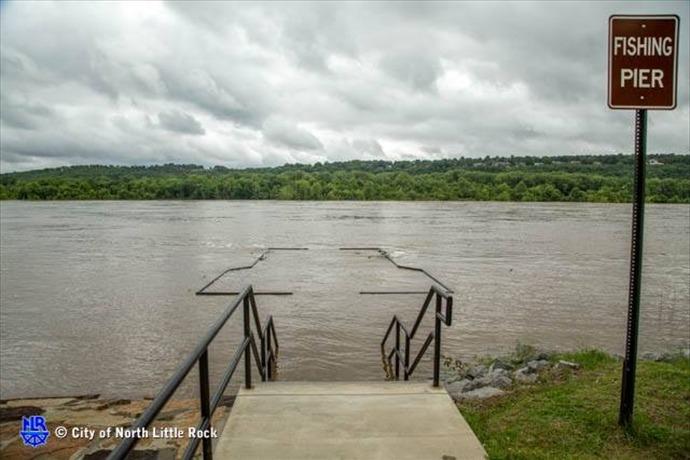 Flooded fishing pier on Arkansas River in NLR near west side of Burns Park._-4056502370459958953