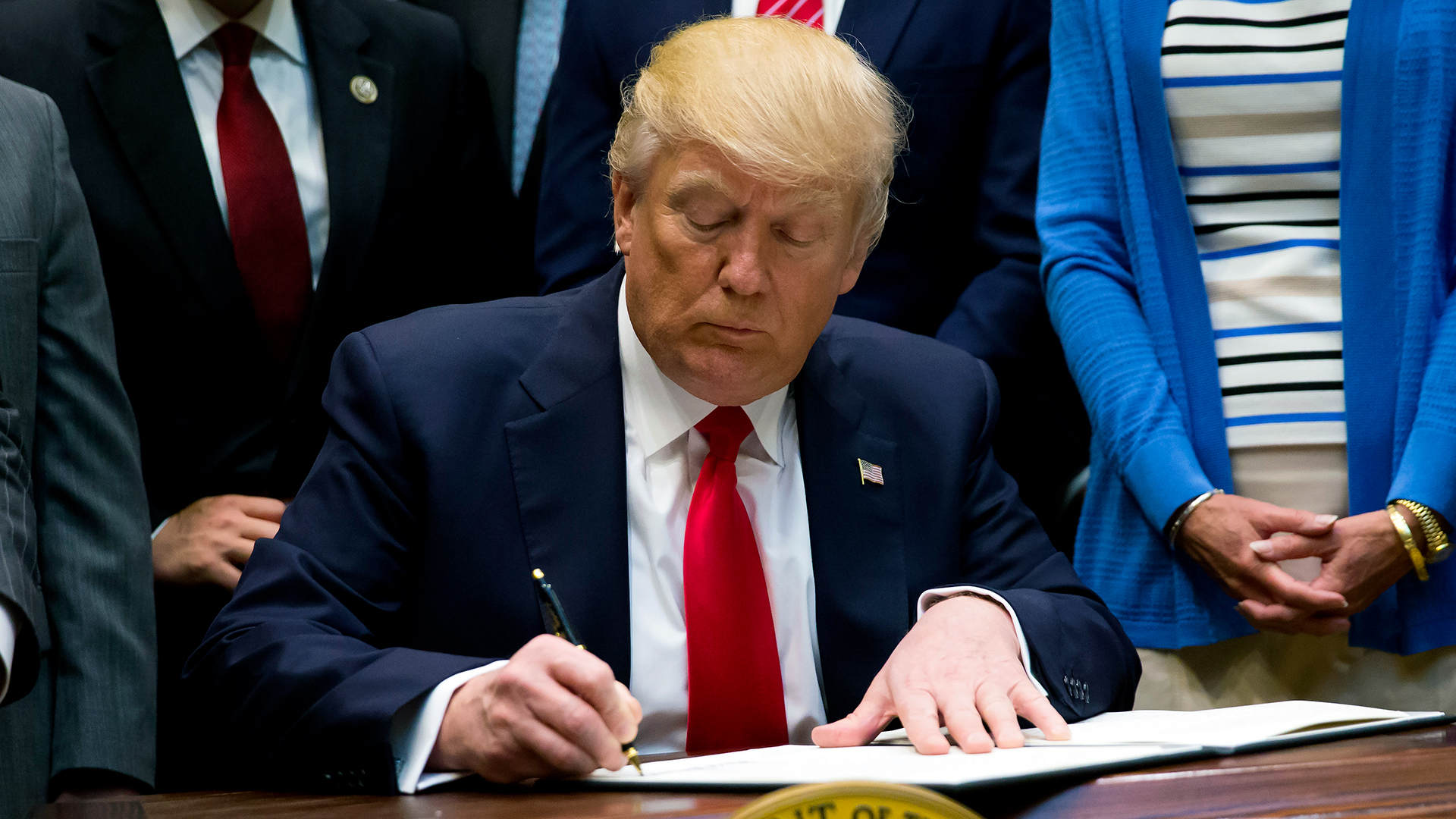 President Trump signing an executive order-159532.jpg84960344