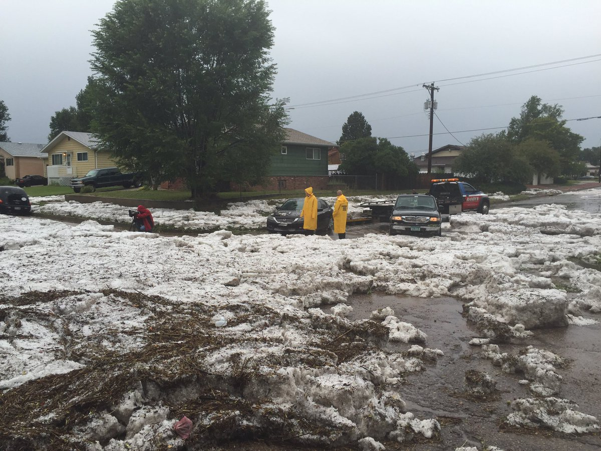 Cars stranded in hail at Mount Vernon Street and Tweed Street, near the intersection of Union Boulevard and Palmer Park Boulevard in Colorado S_188974