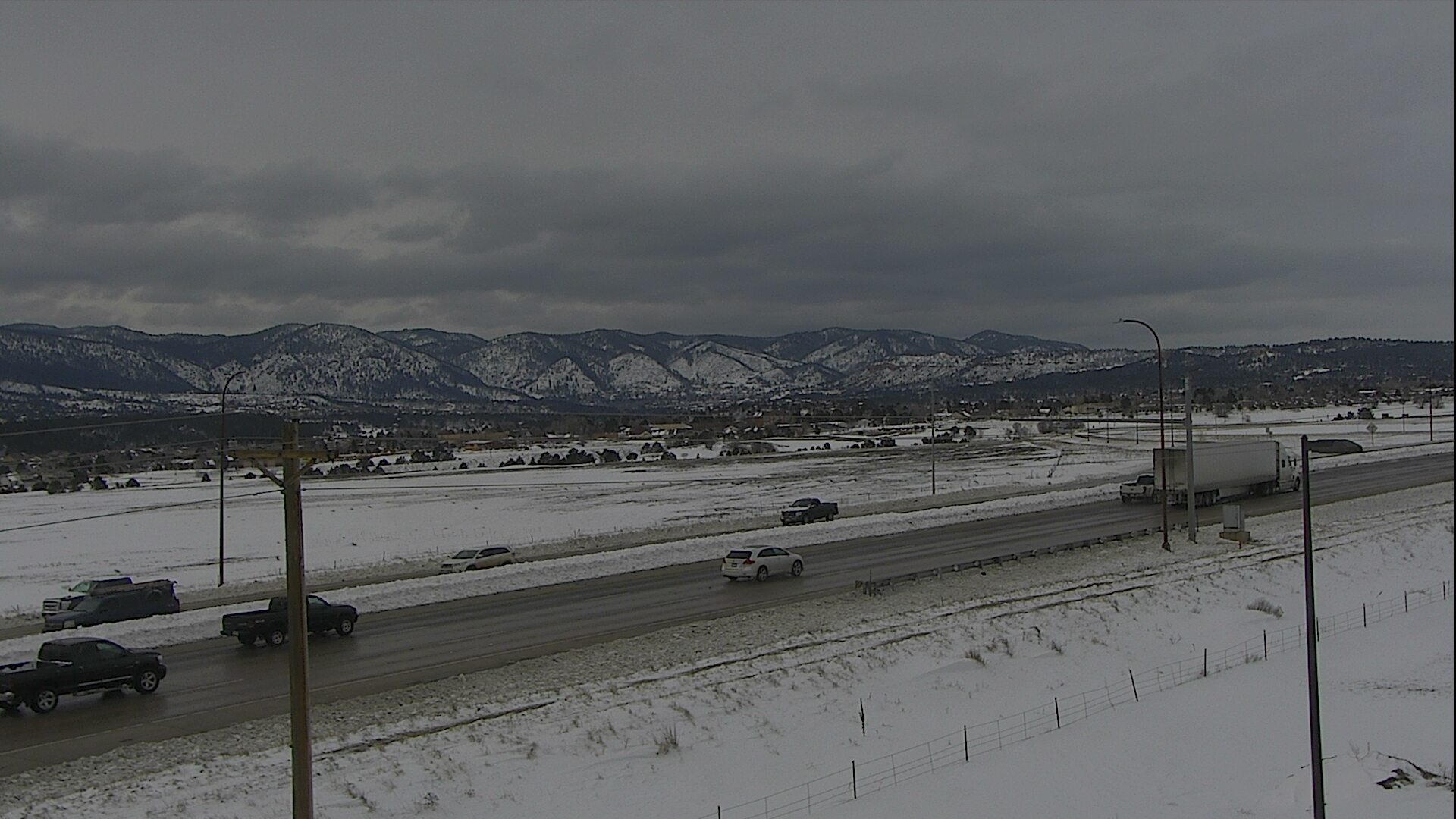Traffic moves along Interstate 25 in Monument just after the highway reopened Thursday afternoon. Still from FOX21 Skycam Network video