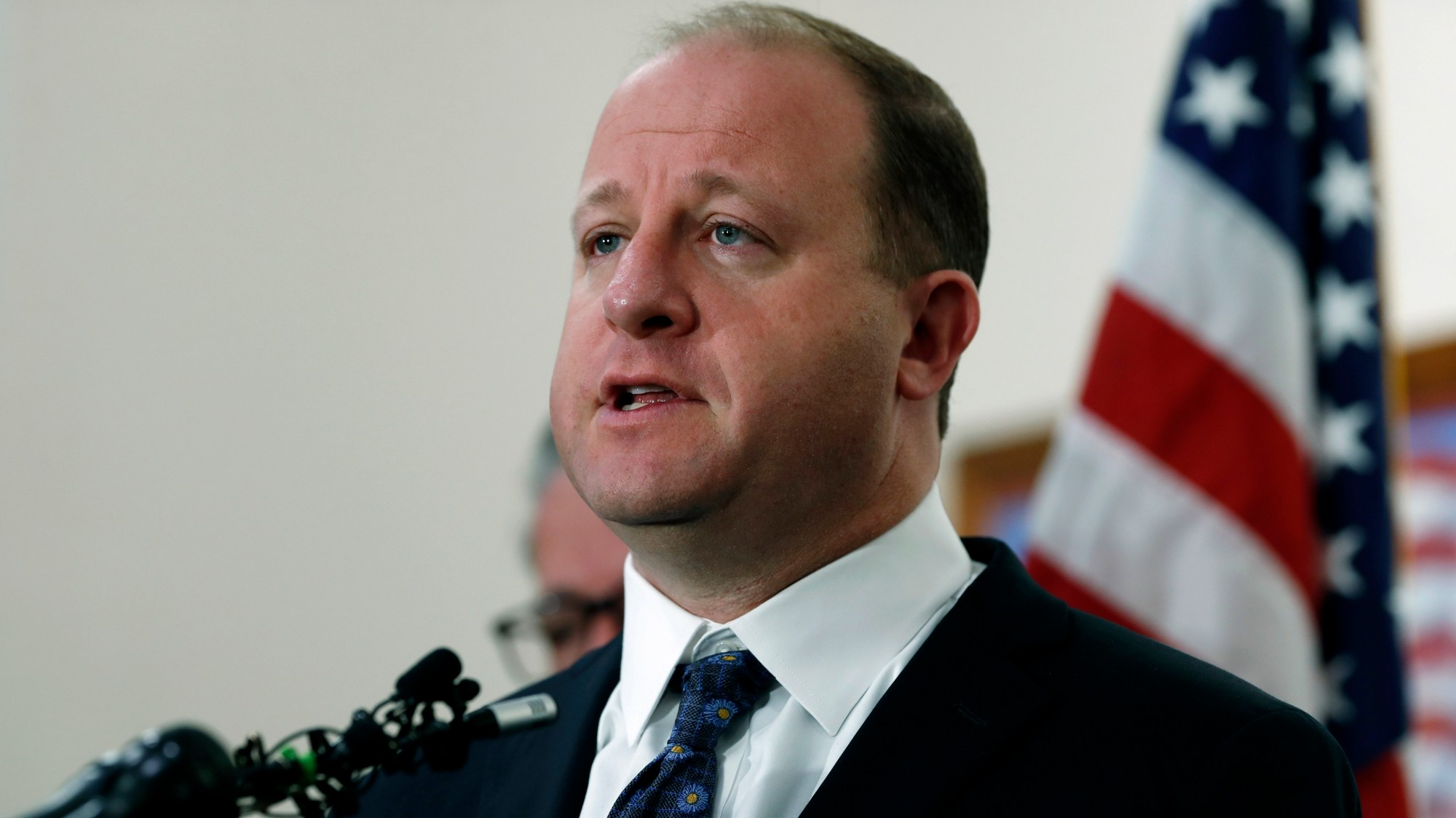 FILE - In this May 8, 2019, file photo, Colorado Gov. Jared Polis responds to a question about a shooting at a charter school during a news conference in Highlands Ranch, Colo. (AP Photo/David Zalubowski, File)