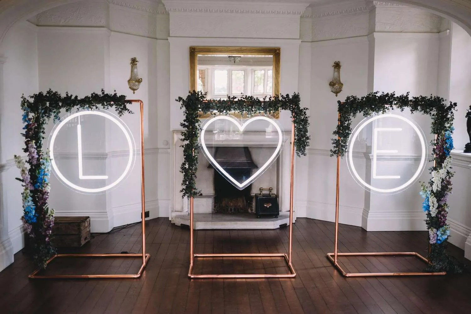 A giant neon heart with faux flowers