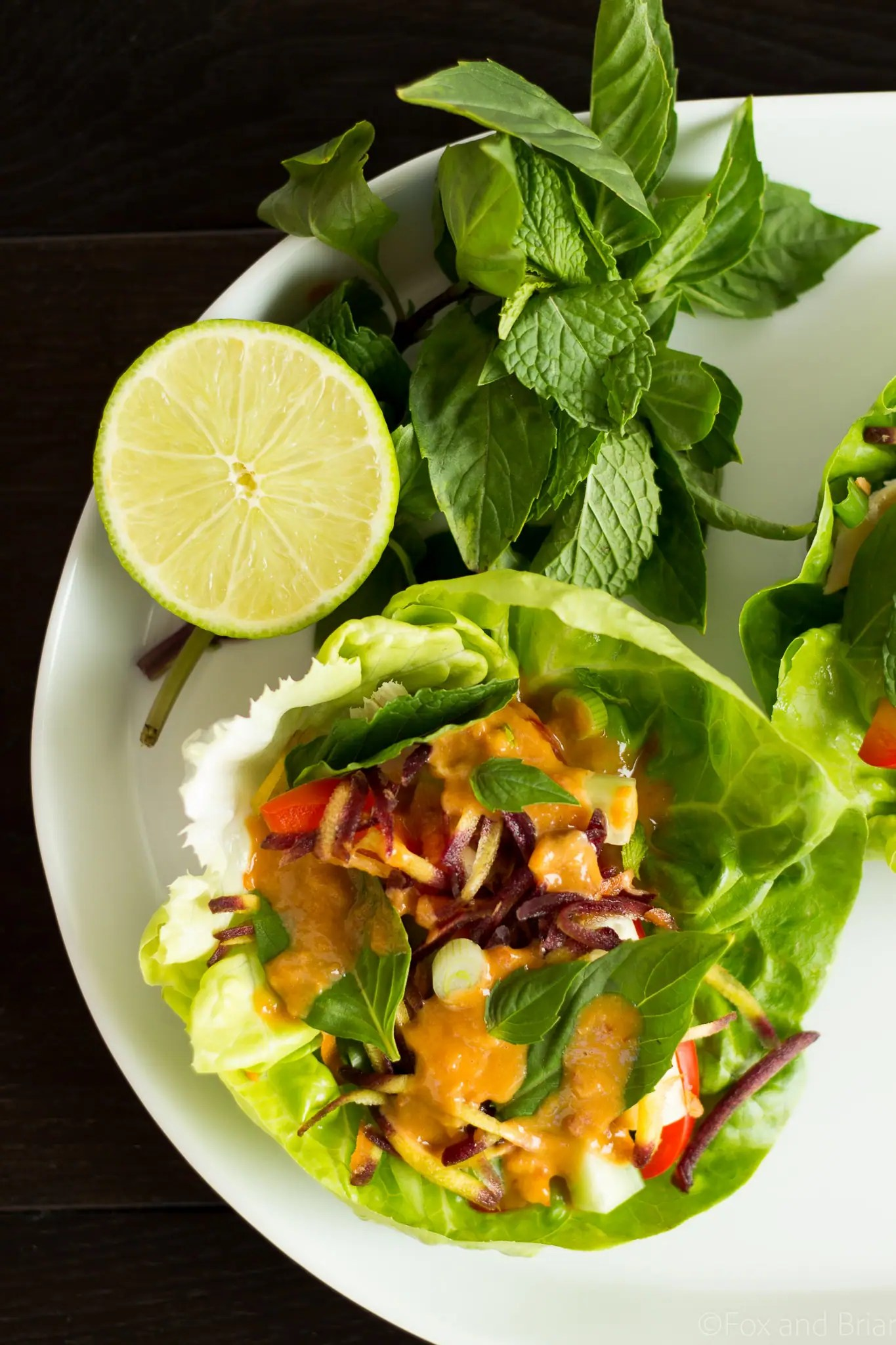 These Ginger peanut lettuce wraps are filled with colorful veggies, your protein of choice, and the most addictive peanut sauce ever!
