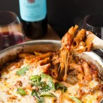 This easy One Pot Pasta Bake with Sausage and Wine takes only uses one pan - you don't even need to boil the noodles! It only take about ten minutes to prep, then bake it in the oven while you do something else! You won't believe how easy it is to make this delicious, cheesy pasta dinner! #sponsored #TasteofItaly