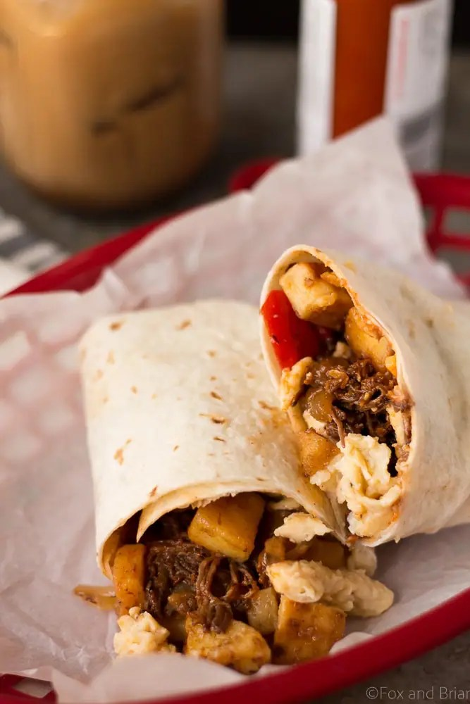 These Make Ahead Beef Breakfast Burritos are freezer friendly! Using tender, slow cooker shredded beef, breakfast potatoes, eggs and cheese, they can be made ahead of time and frozen. Just reheat them in the morning for a quick and hearty breakfast! #sponsored #WABeefLove