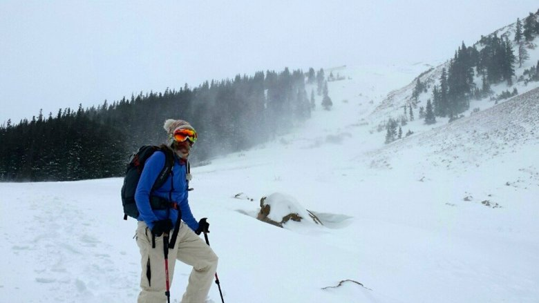 winter hiking and snowshoeing - storm blowing in