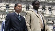 New York Gov. David Paterson, left, and aide David Johnson walk down the steps of the Capitol in Albany, N.Y.