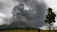Mount Sinabung spews volcanic materials into the sky in Karo, North Sumatra, Indonesia, Monday, Aug. 30, 2010. The volcano that had been dormant for more than four centuries erupted for the second day in a row Monday, spewing out towering clouds of ash and forcing the evacuation of more than 21,000 people.