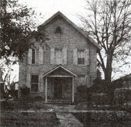 Black and white image of small wood church building