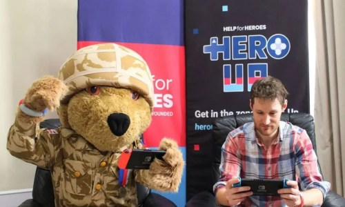 A teddy bear and a gamer playing together to raise money for Help for Heroes