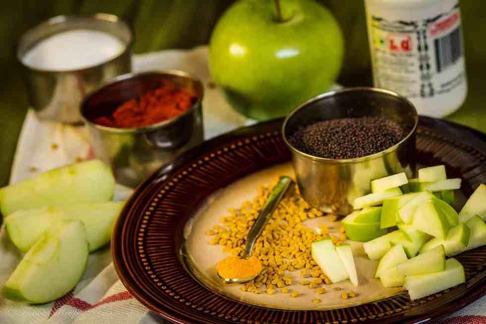 Ingdrients to make apple pickle - granny smoth apple, red chilli powder, salt, hing, mustard seeds, methi seeds and haldi