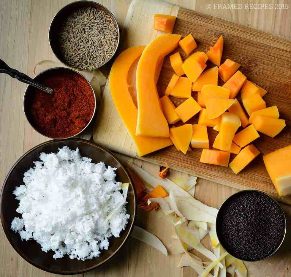some of the ingredients for making erissery - cumin seeds, butternut squash, mustard seeds, coconut and  Indian red chilli powder.