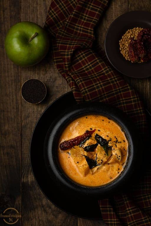 apple pulissery with fresh granny smith apple, methi seeds & red chillies.