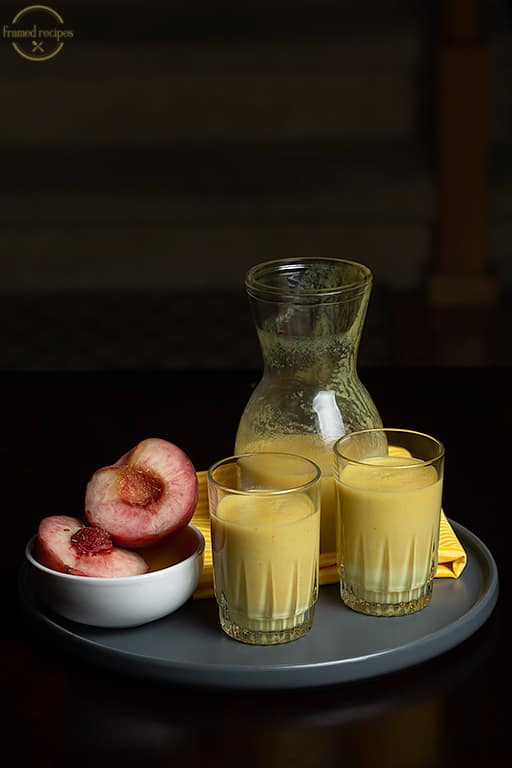two glasses of peach and turmeric smoothie.