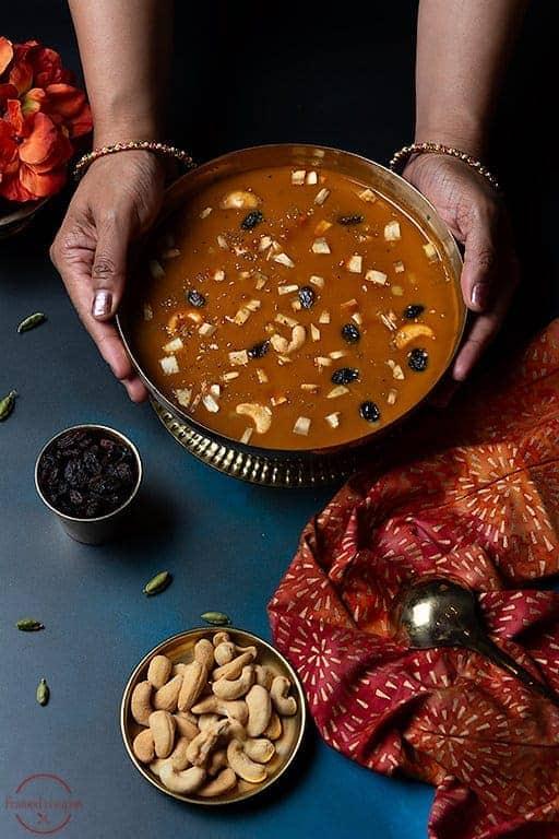 pumpkin pradhaman garnished with coconut pieces, cashews and raisins