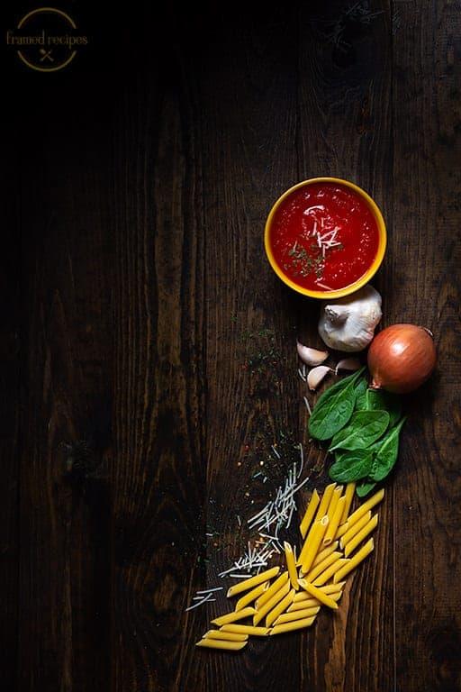 Cajun Spiced Spinach pasta ingredients - pasta, spinach, red chilli flakes, garlic, onion, marinara sauce