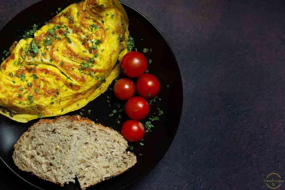 egg omlete served with cherry tomatoes & multi grain bread