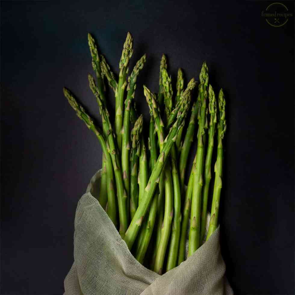 fresh asparagus spears wrapped in cheese cloth