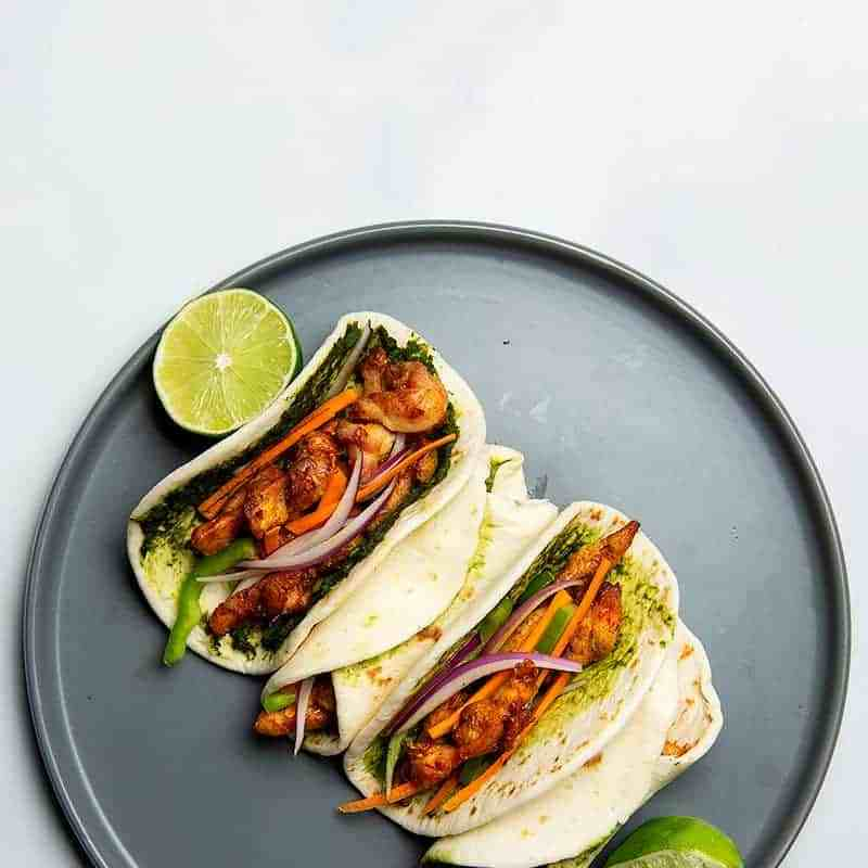 insian inspired chicken wrap served as a roll as well as taco style